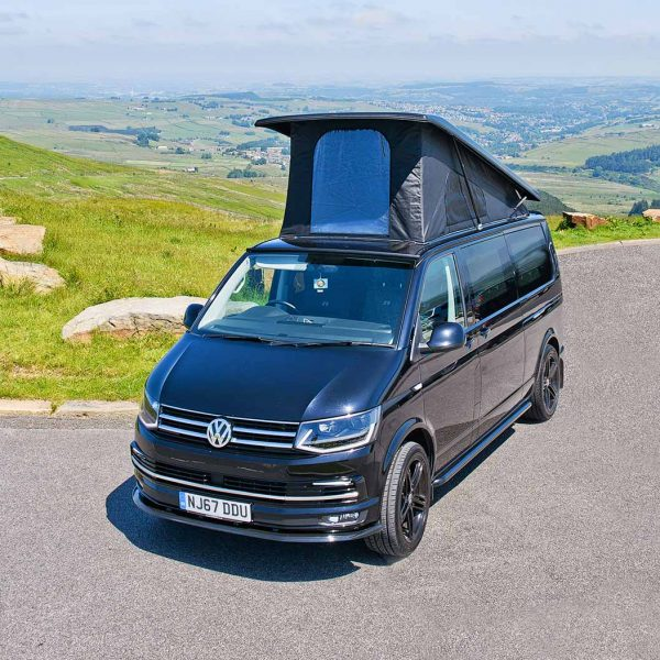 VW Camper van with roof sleeping space extended up