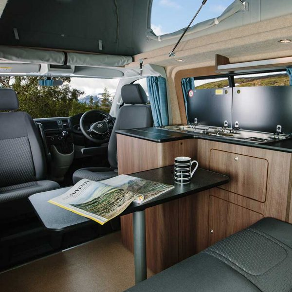 Interior shot of a VW camper van with kitchen area setup