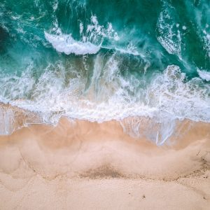 Arial view of beach with rough waves