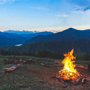Camp fire in a forest overlooking a valley