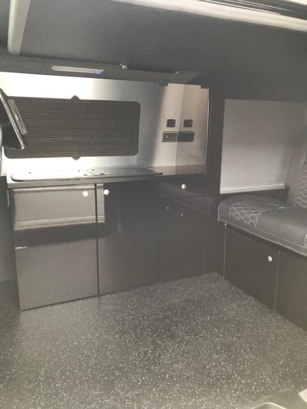 Rear interior of VW camper van without the table setup